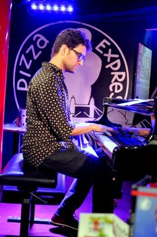 Pianist Albert Sanz in performance with Ed Cherry at Pizza Express in London