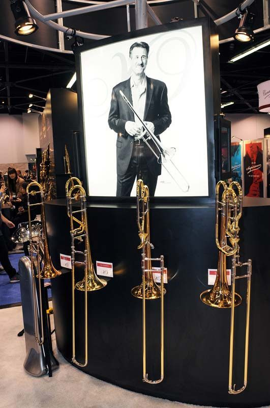 A display at XO Brass featuring John Fedchock and the XO 1632 lead trombone he helped design, NAMM Show 2015