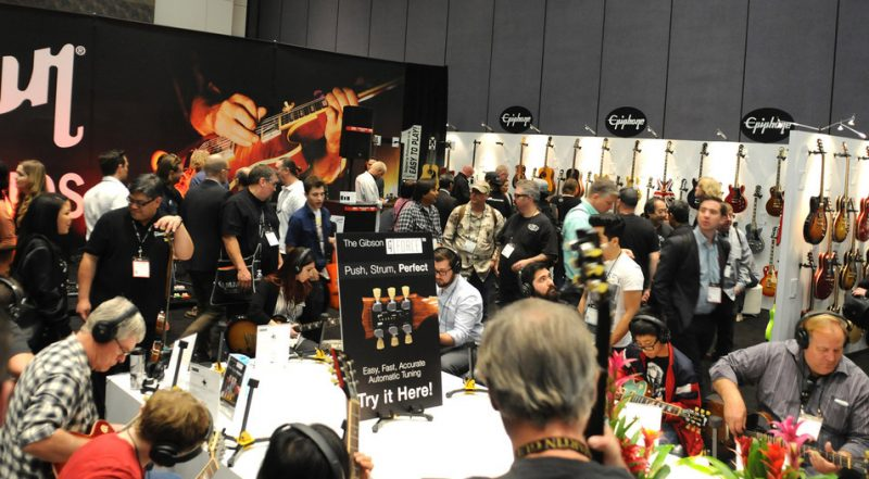Attendees test out Gibson's new G Force automatic tuning system, which comes standard on many of the company's 2015 electric guitars, NAMM Show 2015