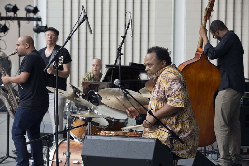 "Jeff ""Tain"" Watts' quintet (l. to r.): Troy Roberts on saxophone, Paul Bollenback on guitar, David Budway on piano, Watts on drums and Chris Smith on bass. At the Charlie Parker Jazz Festival, NYC 8/15"