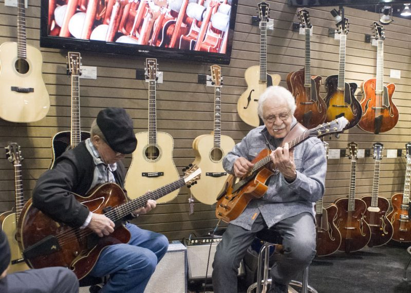 John Pisano (right) and Barry Zweig jam at the Eastman Guitars booth, NAMM 2016