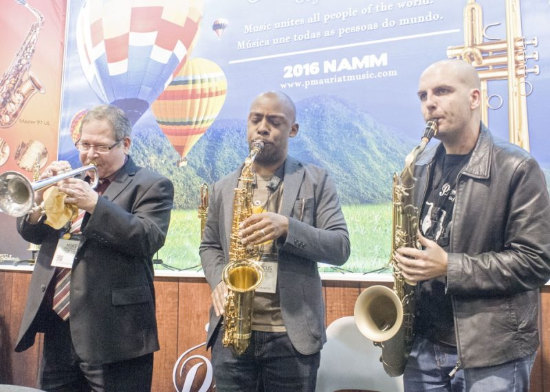 Mike Williams (lead trumpeter, Count Basie Orchestra), Marcus Strickland and Pedrosaxo (from left) at the P.Mauriat booth, NAMM 2016