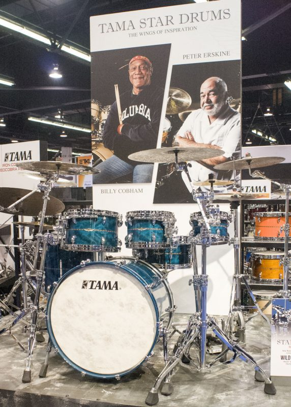 Images of Billy Cobham and Peter Erskine advertise Tama's Star drum series at NAMM 2016