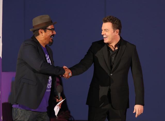 Master of ceremonies George Lopez greets vocalist Seth MacFarlane