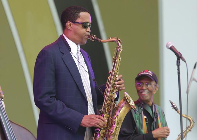 Tenor saxophonist Javon Jackson with saxophonist Jimmy Heath (background)