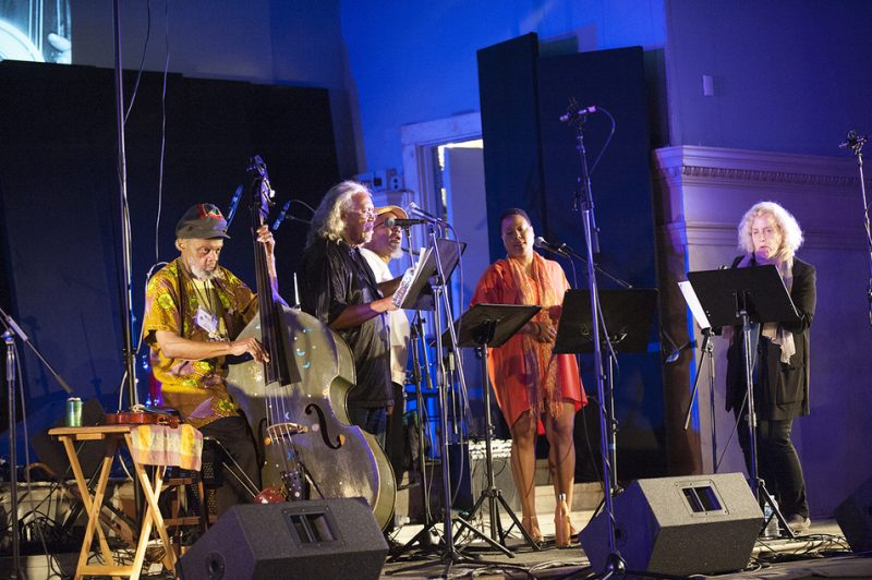 Bassist Henry Grimes and a vocal choir perform songs by Lisa Sokolov (far right) and poems by Grimes at Vision Festival 21; New York's Judson Memorial Church, June 7, 2016