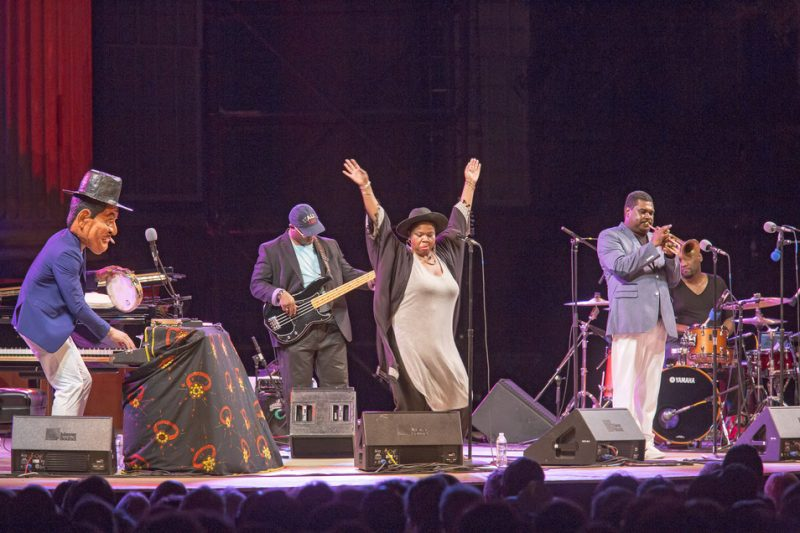 Jason Moran (wearing Fats Waller mask) and band, including singer Lisa E. Harris and trumpeter Donvonte McCoy, pay tribute to Waller at the 2016 Spoleto Festival USA