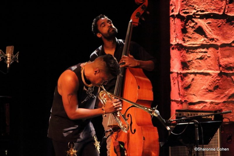 Christian Scott aTunde Adjuah and bassist Kris Funn perform at the 2016 Montreal International Jazz Festival