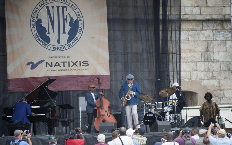 The Charles Lloyd New Quartet at the 2016 Newport Jazz Festival; note Kamasi Washington at far right, checking out the set