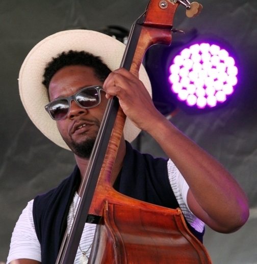 Bassist Ben Williams performs at the 2016 Newport Jazz Festival (photo by Ken Franckling)
