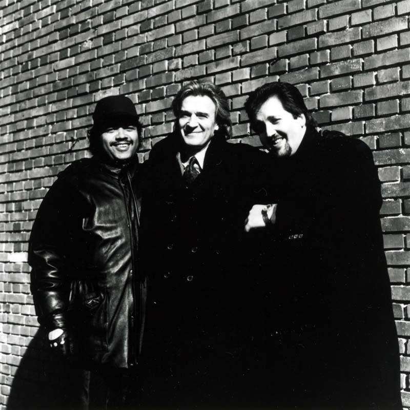 John McLaughlin, flanked by drummer Dennis Chambers (left) and organist Joey DeFrancesco, in the mid-'90s