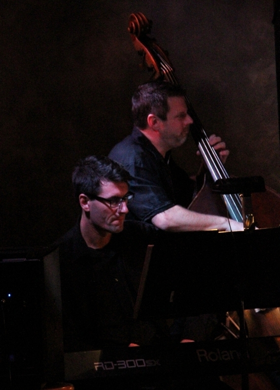 Bassist Bryan Rizzuto and keyboardist Jiri Nedoma perform with the John Allmark Jazz Orchestra
