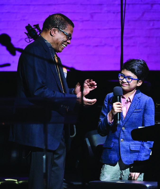 Alexander addresses his hero Herbie Hancock at the Apollo in 2014