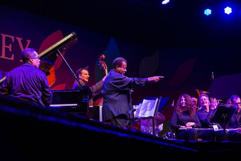 "With his quartet and a 10-piece wind ensemble conducted by Nicole Paiement, Wayne Shorter premieres ""The Unfolding"" at the 2016 Monterey Jazz Festival"