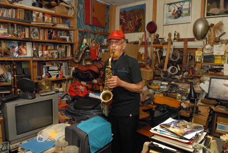 At the Sun Ra house and headquarters in Philadelphia's Germantown neighborhood, Allen plays in his study, where he composes