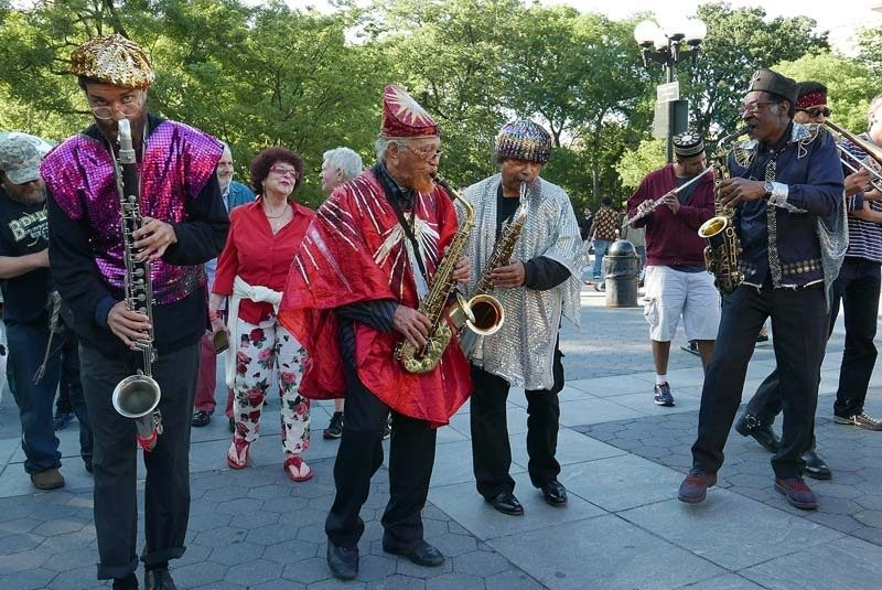 The Arkestra, including reedists Mike Watson, Allen, Terry Lawson and Knoel Scott (from left), parades through Washington Square Park in June