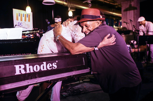 DC Jazz Festival Artistic Director Willard Jenkins hugs pianist-composer Michele Rosewoman after her performance