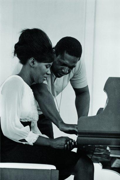 Alice and John Coltrane at the 1966 Newport Jazz Festival (photo by Joe Alper/courtesy of the Joe Alper Photo Collection LLC)