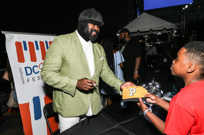 Gregory Porter signs an autograph for a young fan (Photo by Jati Lindsay)