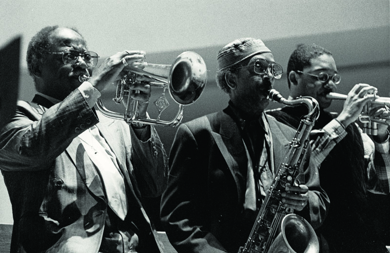 Jimmy Heath with Clark Terry (left) and Wynton Marsalis at Red Rodney's memorial in June 1994; Saint Peter's Church, New York City (photo by Alan Nahigian)