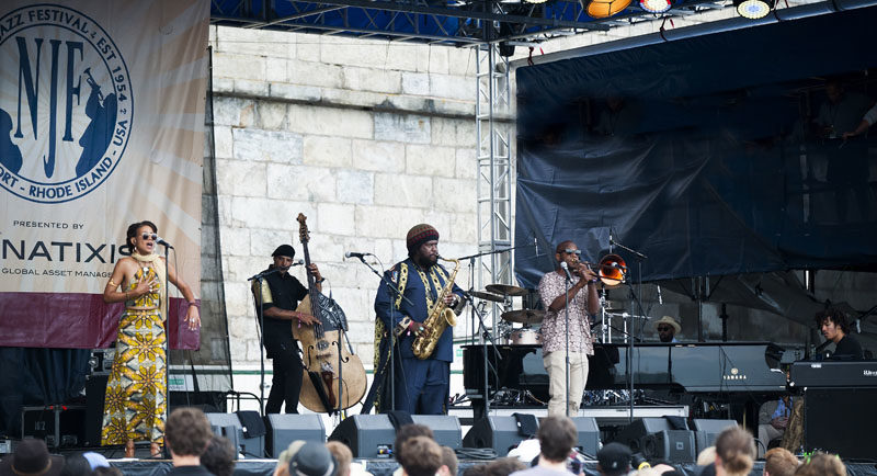 """They learned from me and I've learned from them,"" Washington says of his bandmates. ""It's joyful."" Patrice Quinn, Miles Mosley, the saxophonist and Ryan Porter (from left) on the main stage at last year's Newport Jazz Festival (photo by Marek Lazarski)"