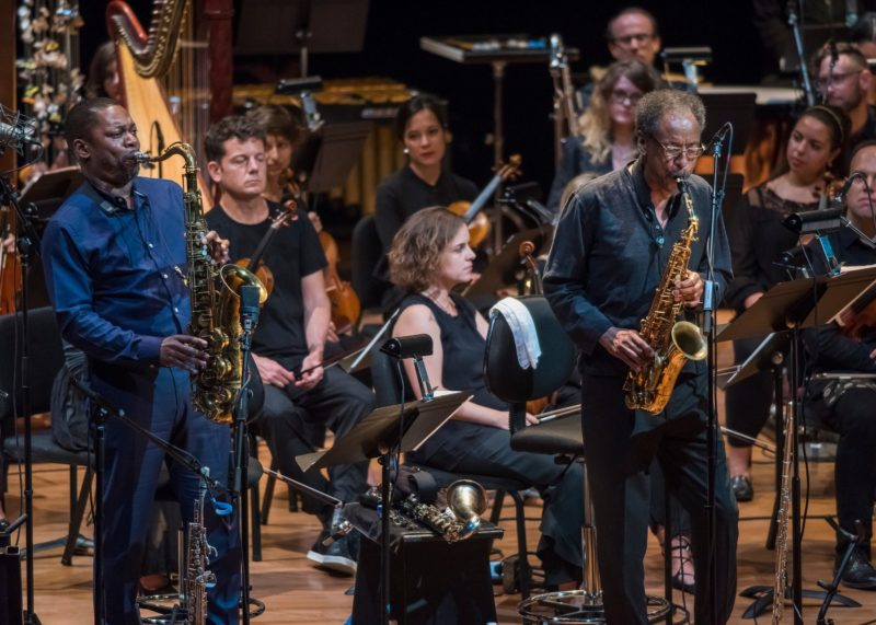 "from left: saxophonists Ravi Coltrane and Henry Threadgill with Ensemble Signal during live orchestral accompaniment of ""Naked Lunch"" (photo by Stephanie Berger)"
