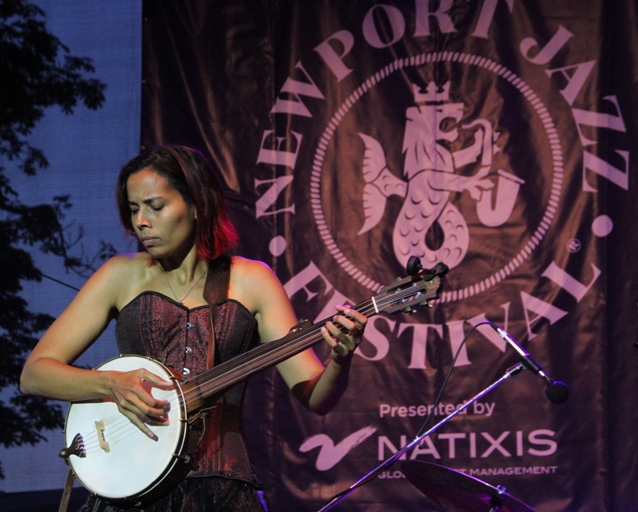 Singer-multi-instrumentalist Rhiannon Giddens at the Newport Jazz Festival's opening night performance at the International Tennis Hall of Fame at Newport Casino, which was the festival's original home in 1954.