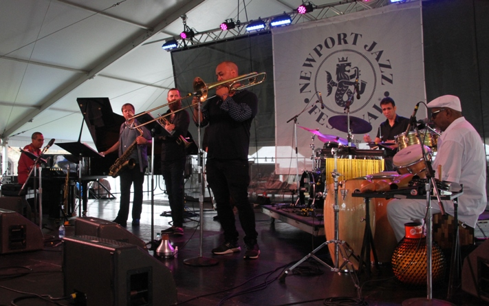 The JAZZ 100 project remembered Dizzy Gillespie, Thelonious Monk, Mongo Santamaria and Ella Fitzgerald on the centennial of their births with its 2017 Newport Jazz Festival set. Pianist Danilo Perez, saxophonist Chris Potter, trumpeter Avishai Cohen, trombonist Josh Roseman, bassist Ben Street, drummer Adam Cruz and percussionist Roman Diaz were in the band. Lizz Wright joined for the Ella segment.