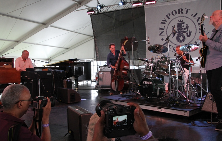 The all-star group Hudson, with drummer Jack DeJohnette, bassist Larry Grenadier, keyboard player John Medeski and guitarist John Scofield, performs at the Newport Jazz Festival on August 6, 2017.