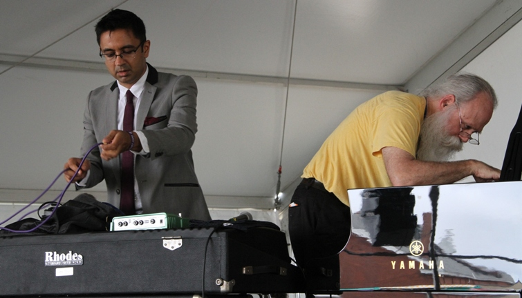 Pianist Vijay Iyer and festival piano tuner Bill Calhoun get things ready for Iyer's Harbor Stage performance with Wadada Leo Smith at the 2017 Newport Jazz Festival on Friday, August 4, 2017. Calhoun has been tuning the festival's pianos for 32 years.