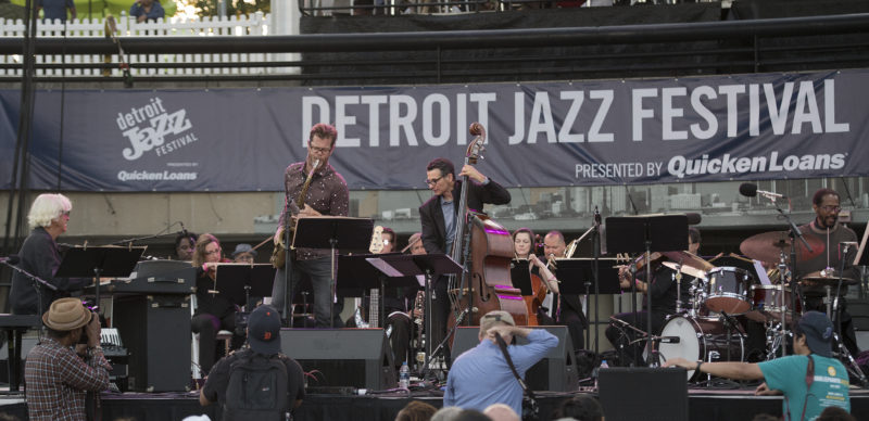 Gil Goldstein, Donny McCaslin, John Patitucci and Brian Blade (from left) pay homage to Michael Brecker at the 2017 Detroit Jazz Festival, with the festival's orchestra