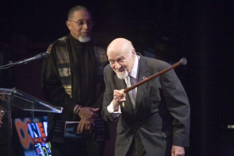 George Avakian accepts his NEA Jazz Master award in New York in 2010; poet A. B. Spellman can be seen at back (photo by Alan Nahigian)