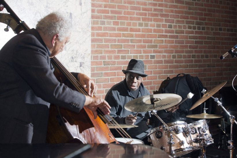 "Rufus Reid (left) and Andrew Cyrille at ""A Musical Tribute to Dr. Muhal Richard Abrams""; the Community Church of New York – Jan. 29, 2018 (Credit: Alan Nahigian)"