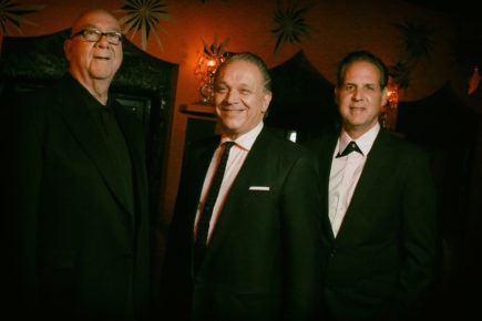 Jimmie Vaughan flanked by drummer George Rains (left) and organist Mike Flanigin (photo credit by Todd V. Wolfson)