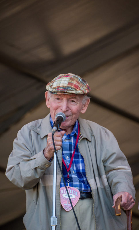 Festival producer George Wein introducing a set at the 2018 New Orleans Jazz & Heritage Festival (photo by Mark Robbins)