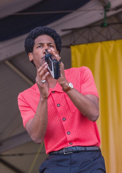 Jon Batiste in performance saluting Fats Domino at the 2018 New Orleans Jazz & Heritage Festival (photo by Mark Robbins)
