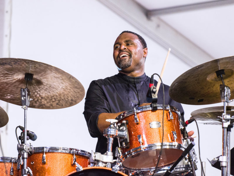 Kendrick Scott in performance with Charles Lloyd at the 2018 New Orleans Jazz & Heritage Festival (photo by Mark Robbins)