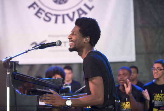 Jon Batiste performs in front of students from the Jazz House Kids Summer Workshop at the 2018 Newport Jazz Festival