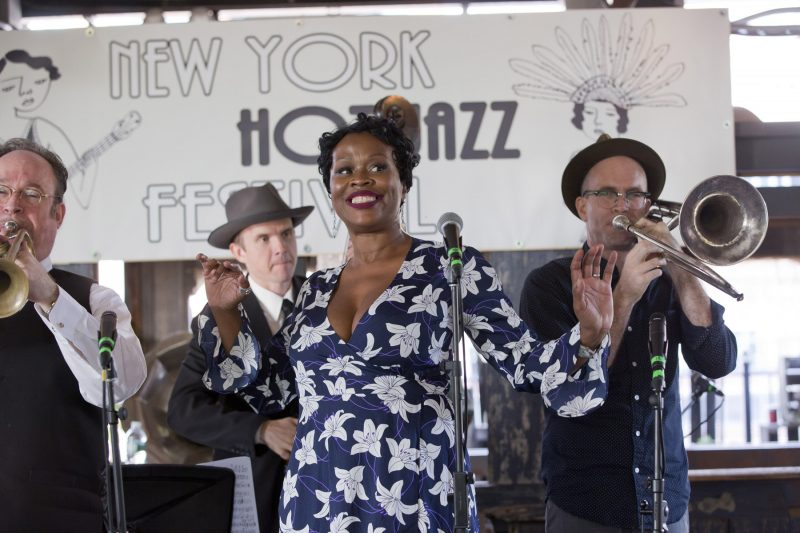 Queen Esther (center) with Jon-Erik Kellso (trumpet), Sean Cronin (bass), and Charlie Halloran (trombone) at the 2018 New York Hot Jazz Festival (photo: Alan Nahigian)