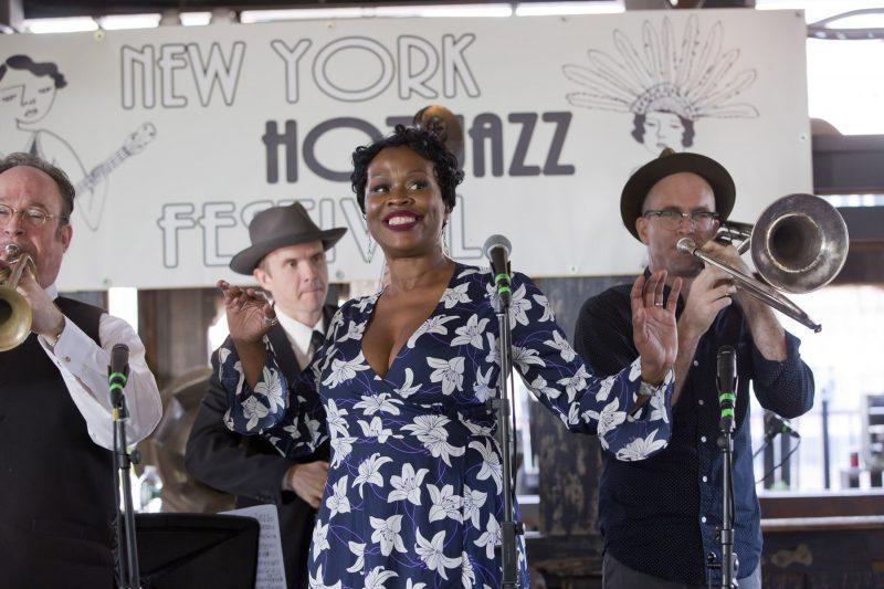 Queen Esther (center) with Jon-Erik Kellso (trumpet), Sean Cronin (bass), and Charlie Halloran (trombone) at the 2018 New York Hot Jazz Festival (photo: Alan Nahigian)