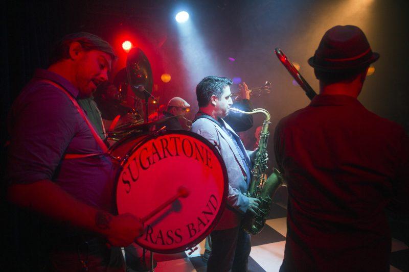 The Sugartone Brass Band (Conor Elms: bass drum, Kenny Bentley: sousaphone, Scott Bourgeois: tenor saxophone) at the 2018 New York Hot Jazz Festival (photo: Alan Nahigian)