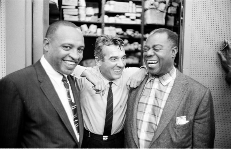 Left to right: Lionel Hampton, Gene Krupa, and Armstrong pose for a photo at a rehearsal for the Timex All Star Jazz show, April 30, 1958. (photo: Maynard Frank Wolfe)