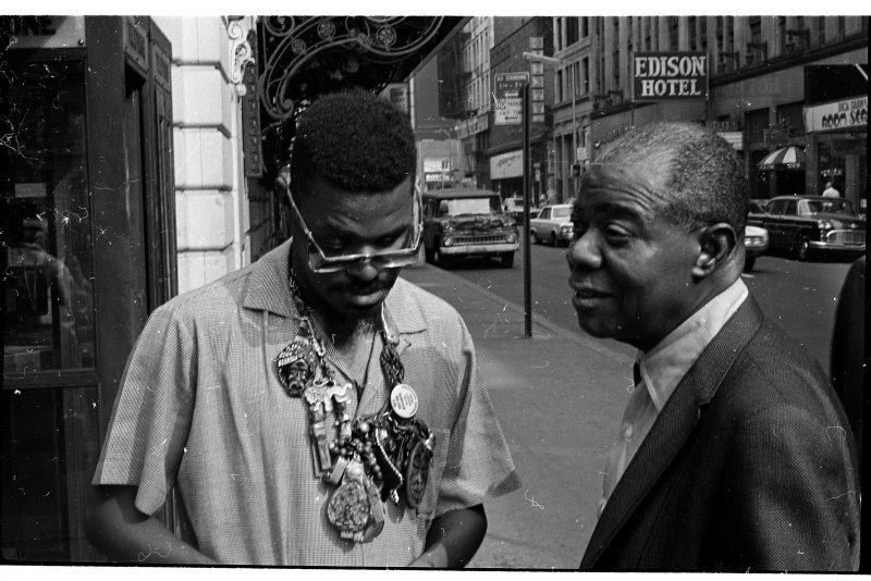 "Rahsaan Roland Kirk and Louis Armstrong chat on W. 47th St. in New York between sessions for Armstrong's final album, ""Louis 'Country and Western' Armstrong,"" 1970 (photo: Jack Bradley)"