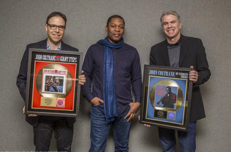 Coltrane Estate attorney Michael B. Frisch, Ravi Coltrane, and Rhino Entertainment president Mark Pinkus with gold discs for Giant Steps and My Favorite Things