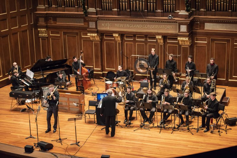 The NEC Jazz Orchestra, conducted by Ken Schaphorst, featuring solo trombonist Michael Prentky and pianist Matthew Thomson; Ran Blake is seated next to Thomson
