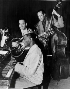 Nat Cole, Oscar Moore, and Johnny Miller performing on the King Cole Trio Time radio program, Jan. 16, 1947
