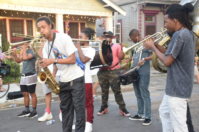 A brass band outside the grounds of the 50th New Orleans Jazz & Heritage Festival