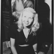 Doris Day (with Les Brown in the mirror) backstage at the Aquarium, New York, July 1946