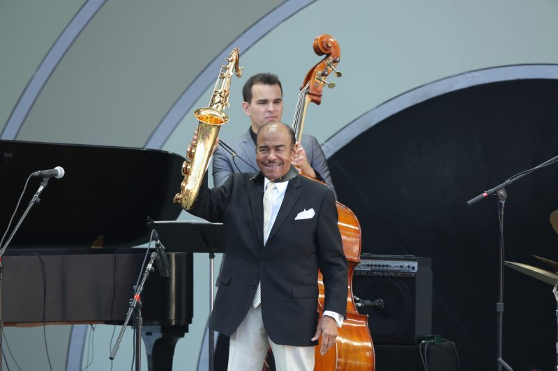 Benny Golson—with Mike Gurrola behind him—at the 2019 Playboy Jazz Festival