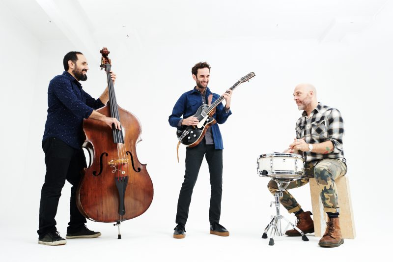 Left to right: Jorge Roeder, Julian Lage, and Dave King (photo: Nathan West)